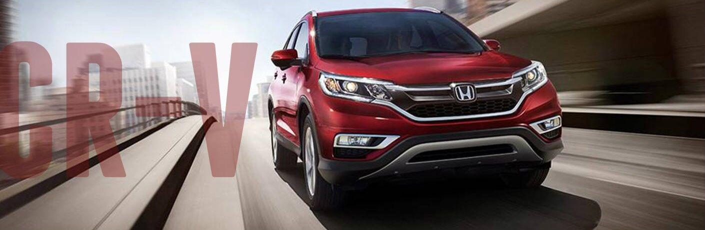 2016 Honda CR-V red front fascia driving cr-v in writing on left side