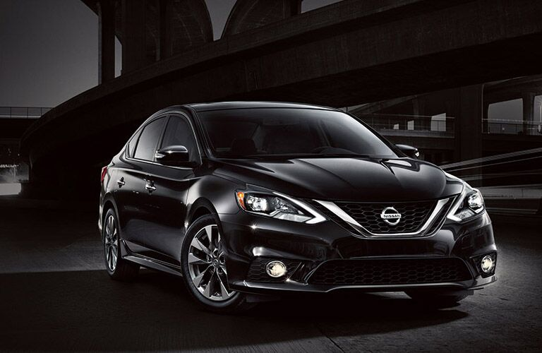 2016 Nissan Sentra in black with a black city background