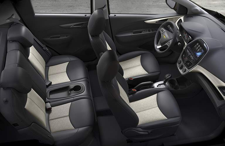 interior of a 2017 Chevy Spark with black and white seating
