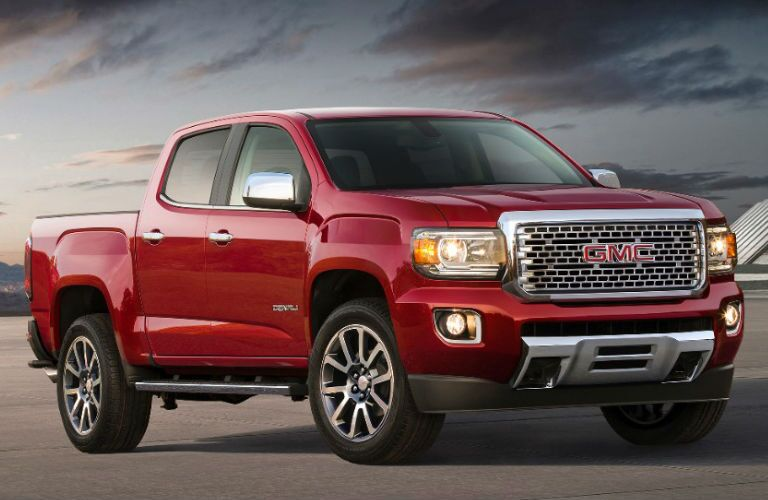 GMC Canyon Denali sits in an open landscape. Exterior front angled view.