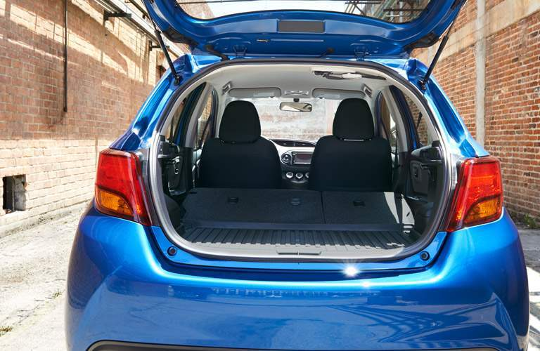2017 Toyota Yaris with the rear hatchback door open to display its cargo space