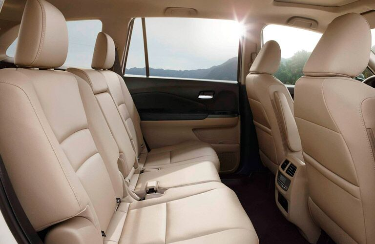 A photo of the second row of seats in a three-row SUV.