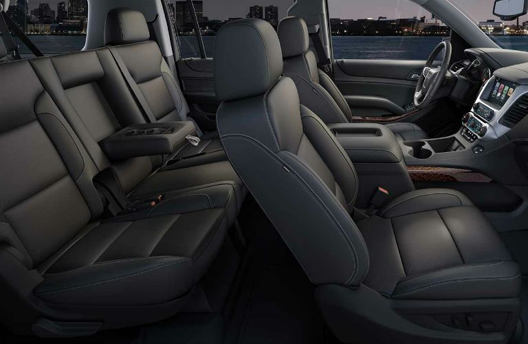 A photo of the first and second row of seats in a used GMC Yukon.