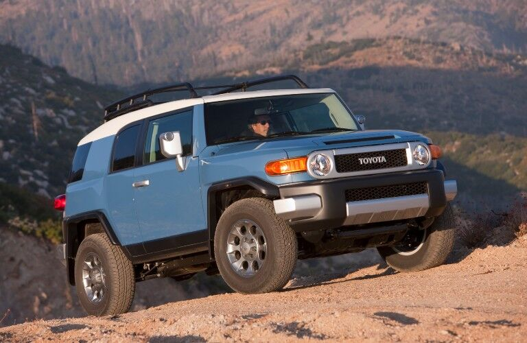 A used Toyota FJ Cruiser parked on a mountain.