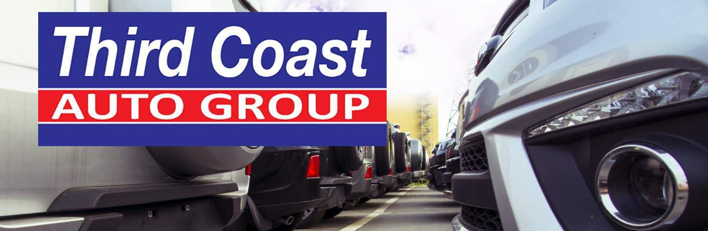 Third Coast Auto Group logo imposed over a view of cars at a dealership parked bumper to bumper