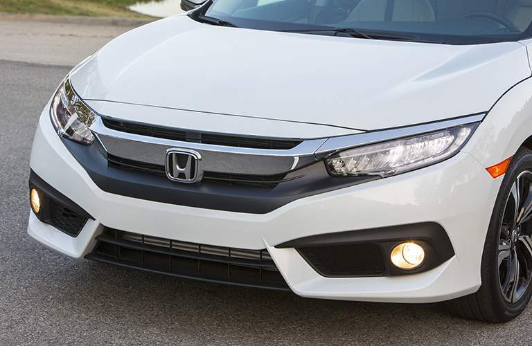 close view of a white 2018 Honda Civic grille