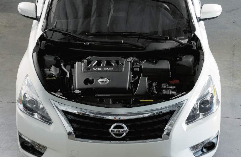 2018 Nissan Altima with the hood open to show the engine, overhead view