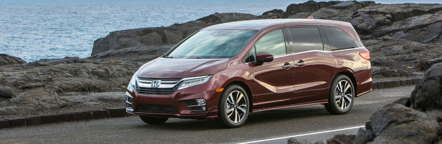 Exterior view of a maroon 2020 Honda Odyssey