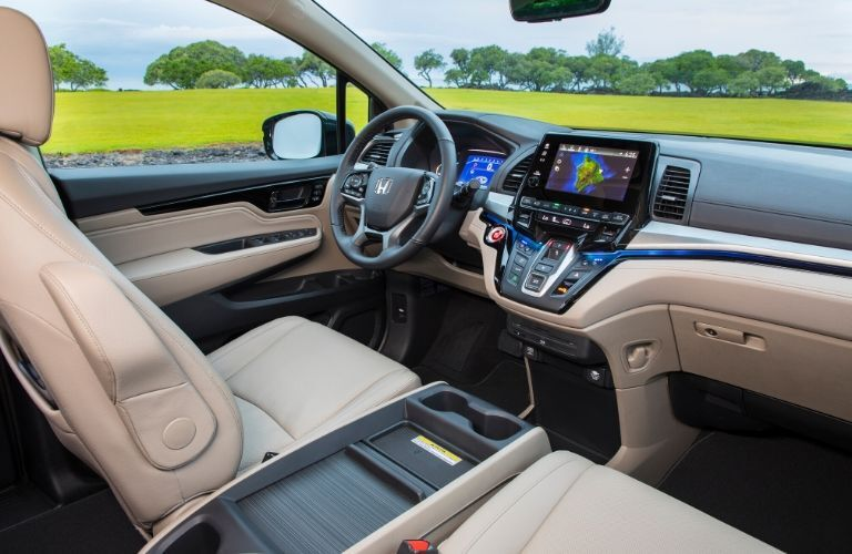 Interior view of the front seating area inside a 2020 Honda Odyssey