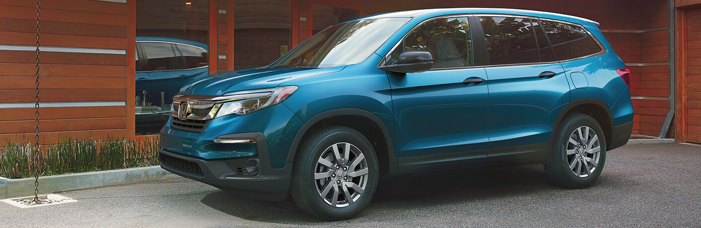 Exterior view of a light-blue 2020 Honda Pilot