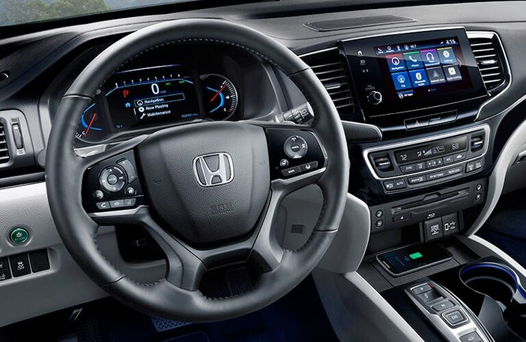 Interior view of the steering wheel and touchscreen inside a 2020 Honda Pilot