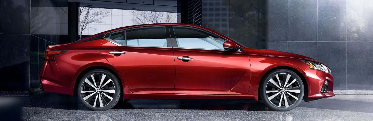 2020 Nissan Altima red parked on concrete in front of building