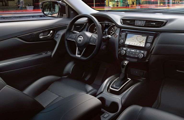 Interior view of the front seating area inside a 2020 Nissan Rogue