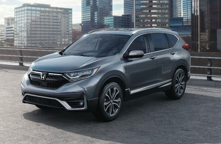 2020 Honda CR-V parked in front of large buildings
