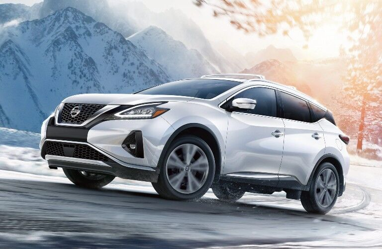2020 Nissan Murano white driving up road dramatic angle_o