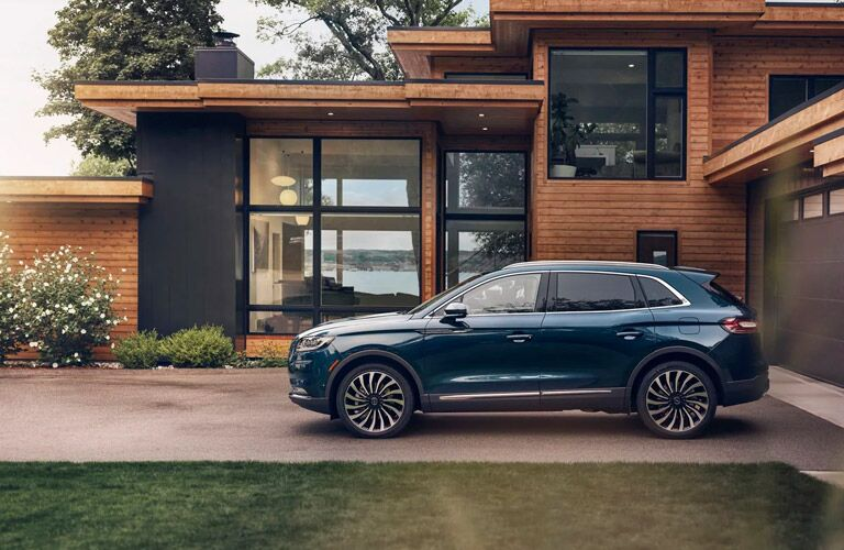 2021 Lincoln nautilus parked outside of a modern home