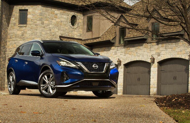 2021 Nissan Murano parked outside a brick house