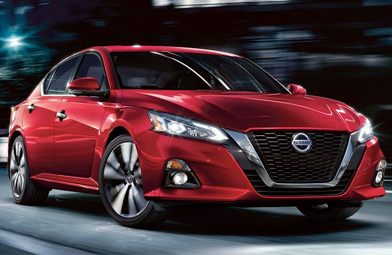 2019 Nissan Altima red driving at night