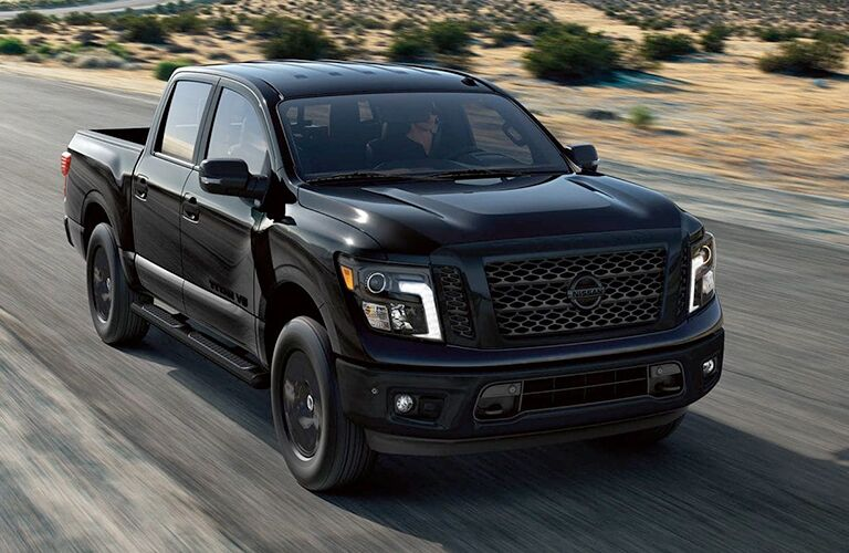 2019 Nissan Titan black driving down road shot from overhead at high speed