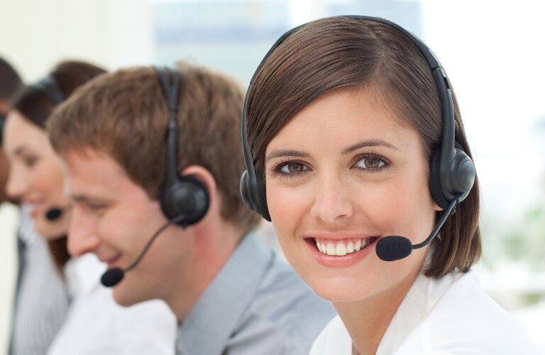 stock photo of customer support people with headsets in a line