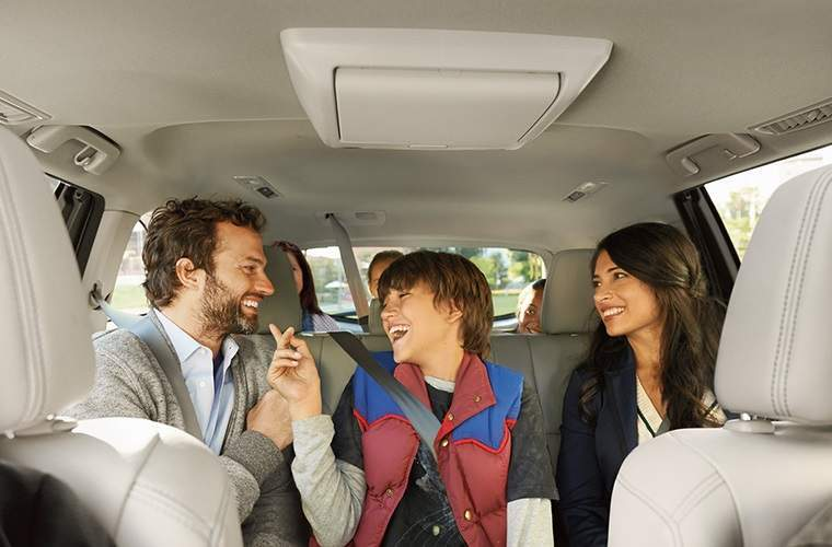 2018 Toyota Highlander family having fun and laughing