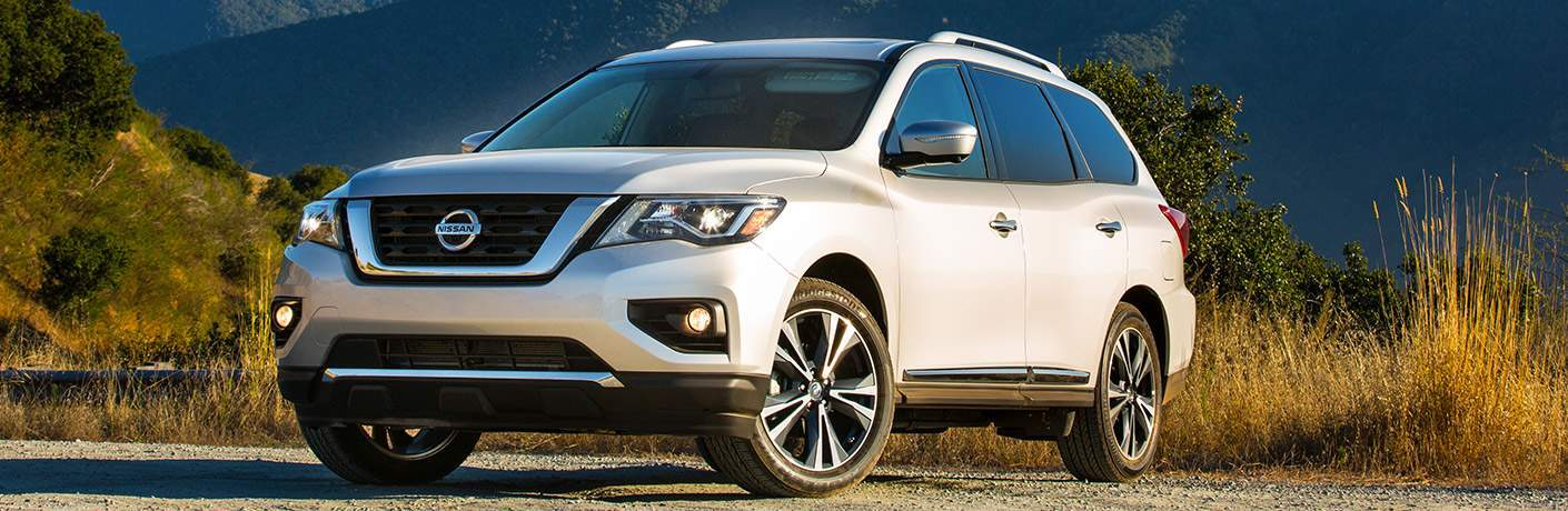 2018 Nissan Pathfinder parked in front of long wild grass