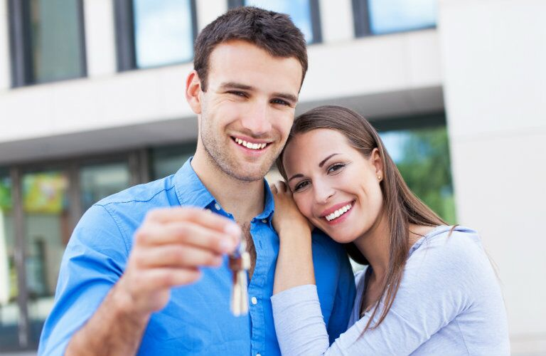 couple with new set of car keys