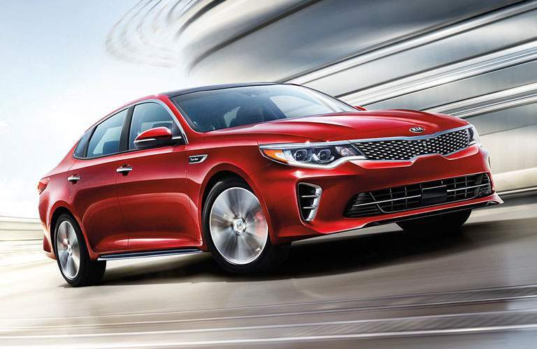An artist's rendering of a red Kia Optima in motion