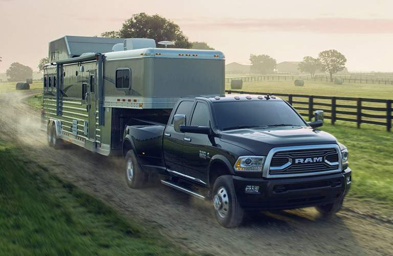 A black Ram 3500 pulling a steel horse trailer