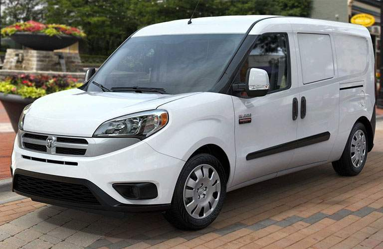 A left front quarter view of a Ram Commercial Van