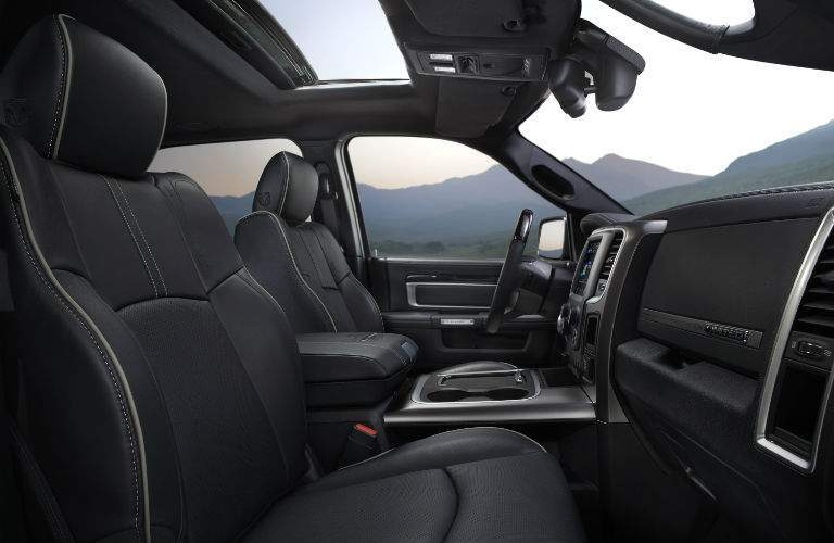 A photo from the passenger side of the 2018 Ram 1500 showing the front half of the truck and many of its features