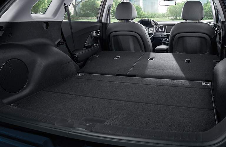 A view of the rear of the 2018 Kia Niro with the back seats folded down for maximum cargo space