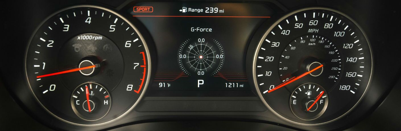A close up photo of the center gauge cluster equipped in the 2018 Kia Stinger.