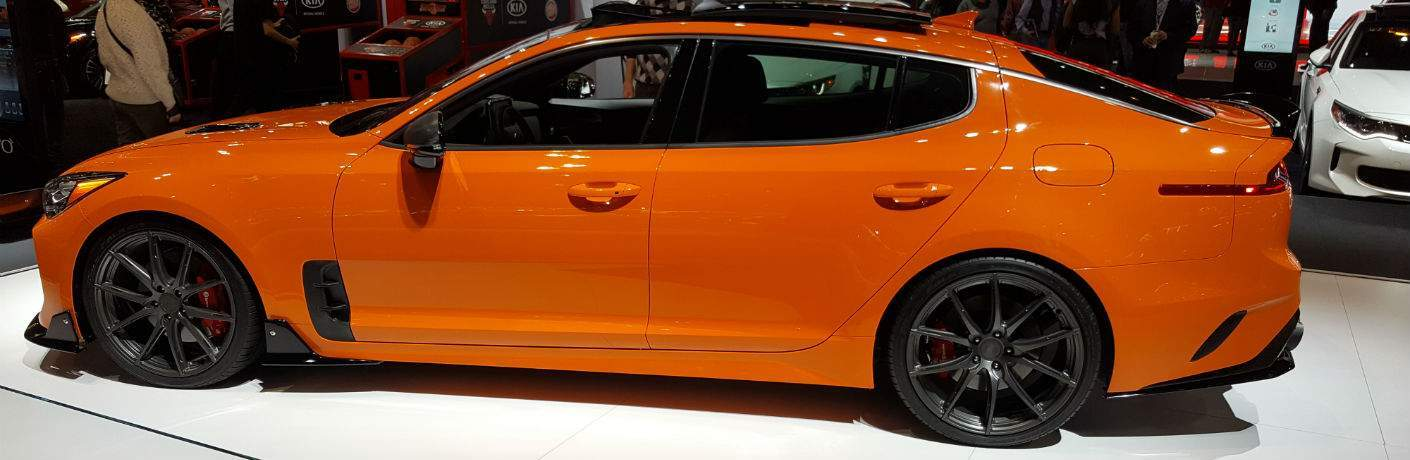 A left profile photo of a 2018 Kia Stinger on display at the Chicago Auto Show