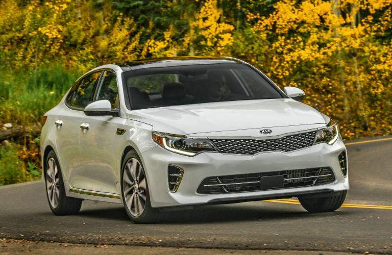 A front view of a white 2018 Kia Optima parked on the road