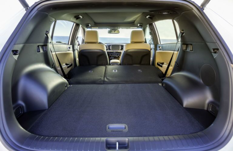 An interior photo showing the maximum cargo space configuration for the 2018 Sportage.