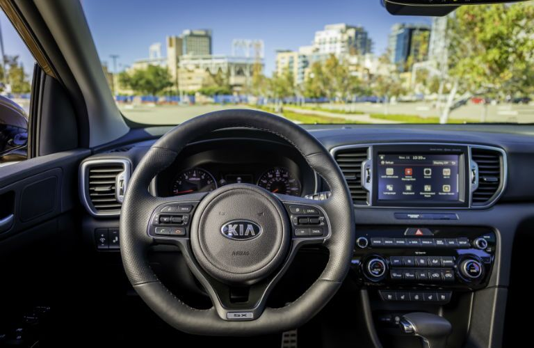 A photo showing the driver's perspective inside of the 2018 Kia Sportage.