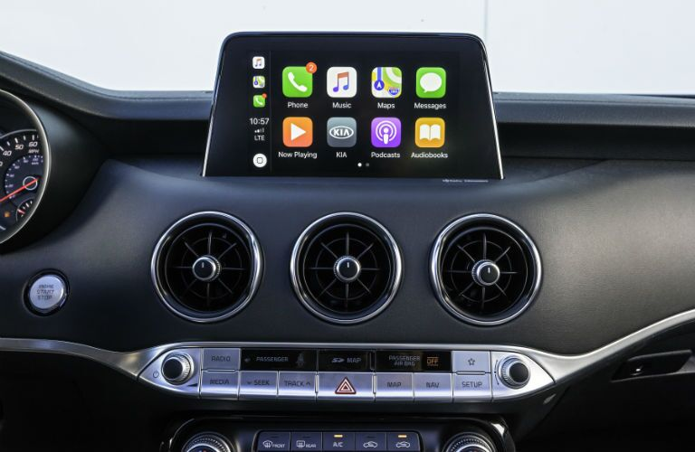 An interior photo showing the infotainment system paired to a smartphone in the 2018 Kia Stinger.