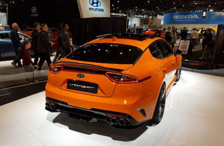 A rear quarter photo of a 2018 Kia Stinger GT on display at the Chicago Auto Show