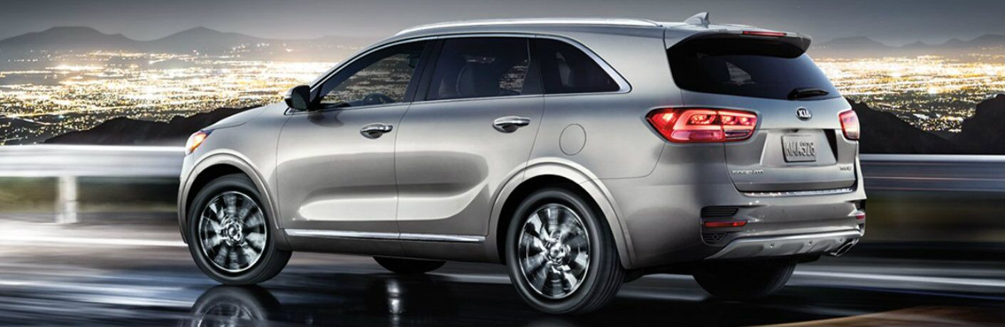 A photo illustration showing the left side of the 2018 Kia Sorento on a road.