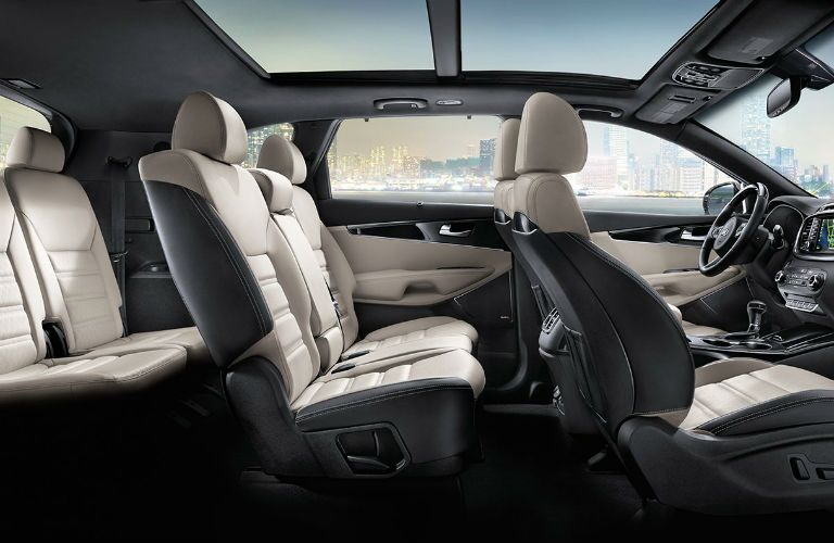 A cut away photo showing the all three rows of seats available inside of the 2018 Kia Sorento.