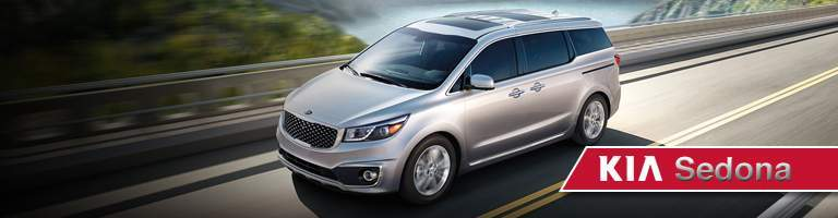 A left profile view of a Kia Sedona available for sale at Spitzer Kia Cleveland