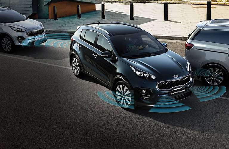 A photo illustration of some of the driver assistance systems available with the 2018 Kia Sportage.
