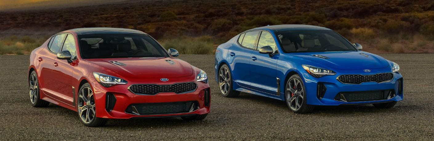 A photo of the 2018 Kia Stinger and Stinger GT parked side-by-side.