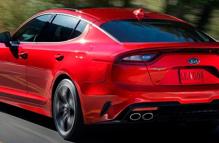 A rear left quarter photo of the 2018 Kia Stinger in motion.