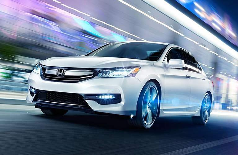 2018 Honda Accord Sedan driving fast with streaking lights