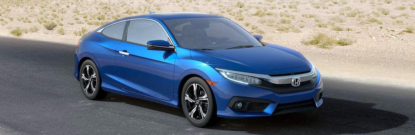 side front view of blue 2018 Honda Civic Coupe