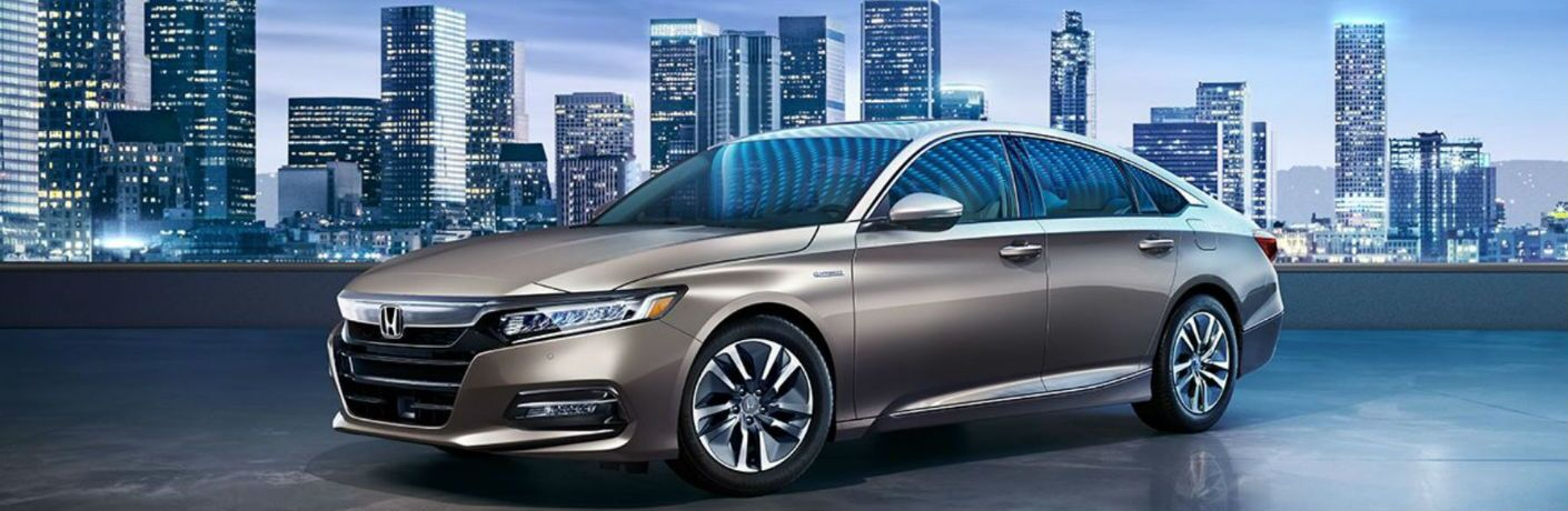 2018 Honda Accord Hybrid on a roof with city in the background