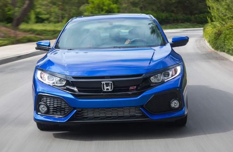 2017 Honda Civic Si driving down the road