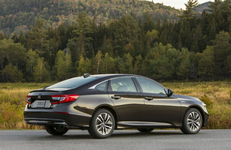 2018 Honda Accord Hybrid right rear angle view in front of a forest